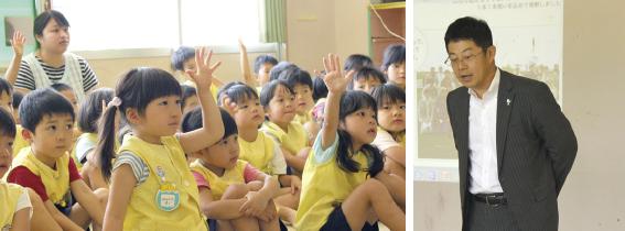 園児からの質問に答える豆崎支店長(写真右)