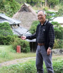 練り歩きの様子を説明する奥村会長